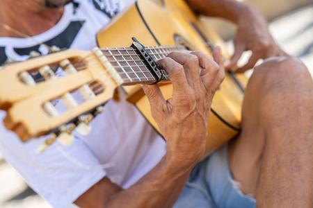 Flamenco musician playing Spanish guitar in Granada
