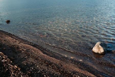 Wild sandy beach in Scandinavia Nature water background