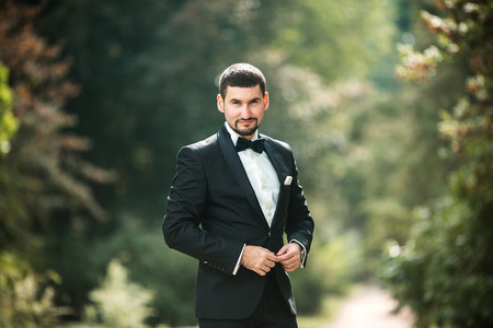 confident groom posing