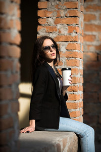 Beautiful girl in glasses with coffee
