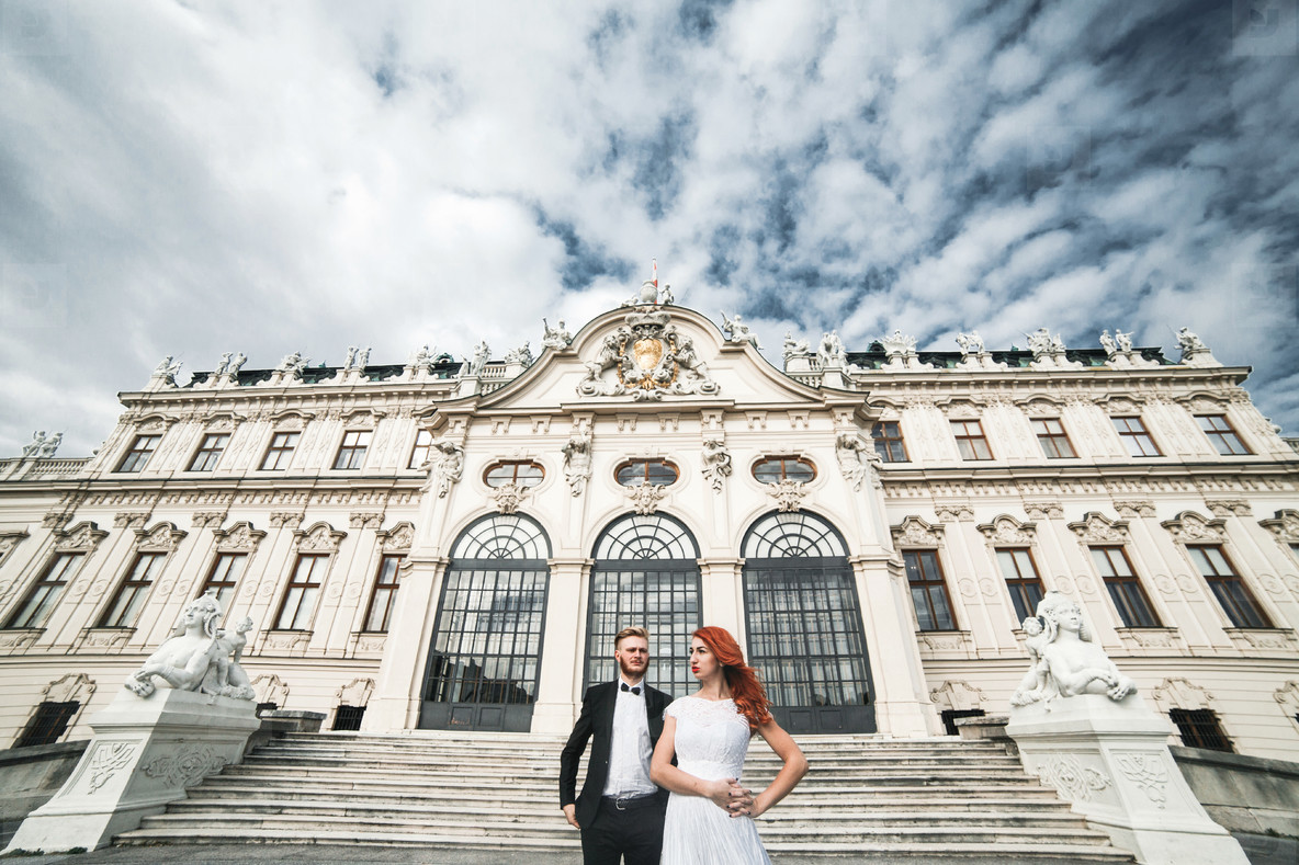 Wedding couple on a walk in the estate of the Belvedere in Vienn