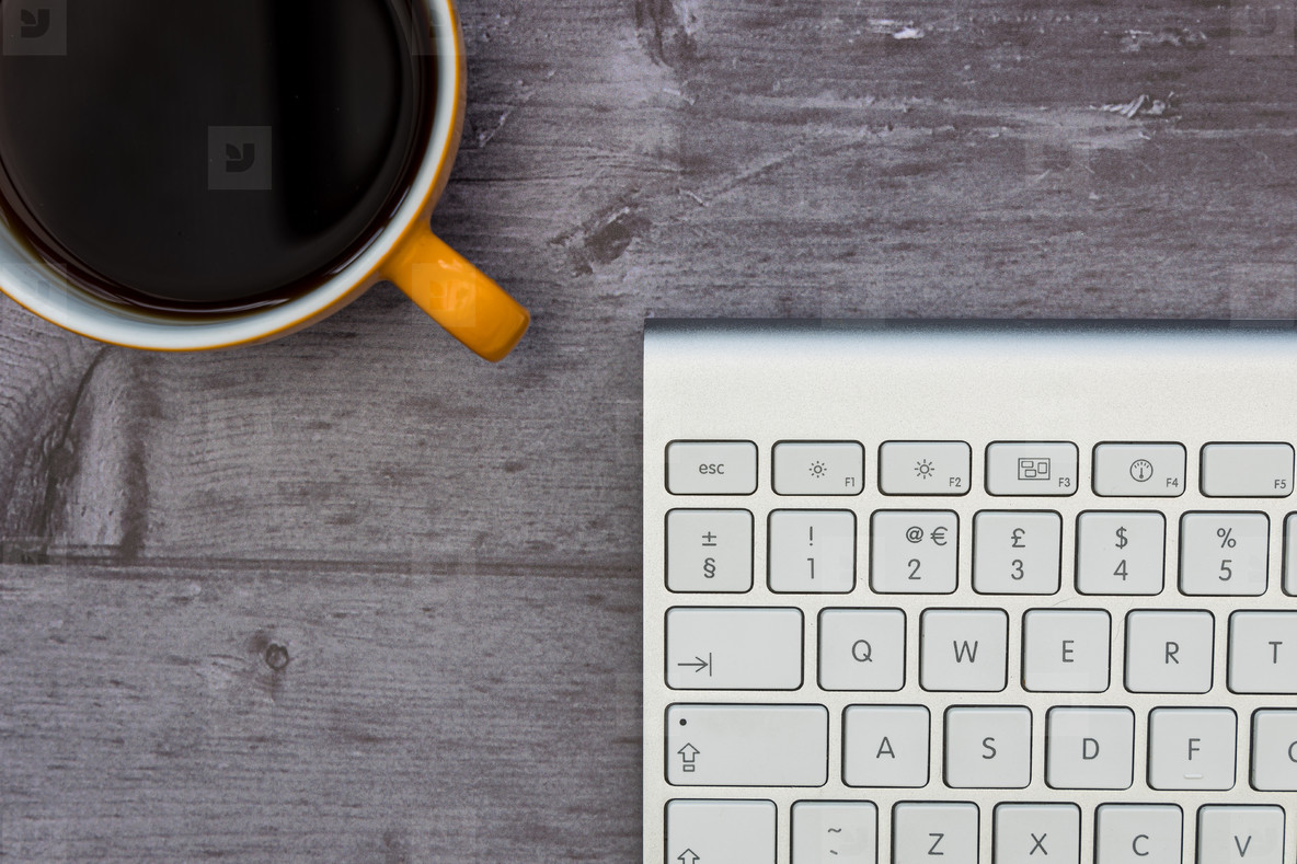 Computer keyboard coffee cup