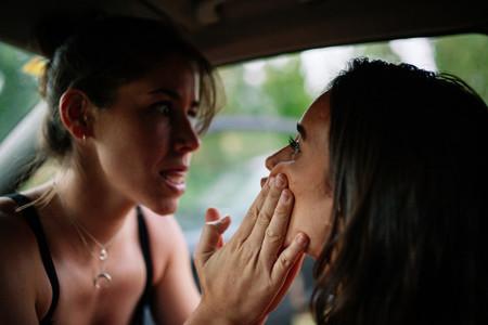 Two young lesbians enjoying inside a car