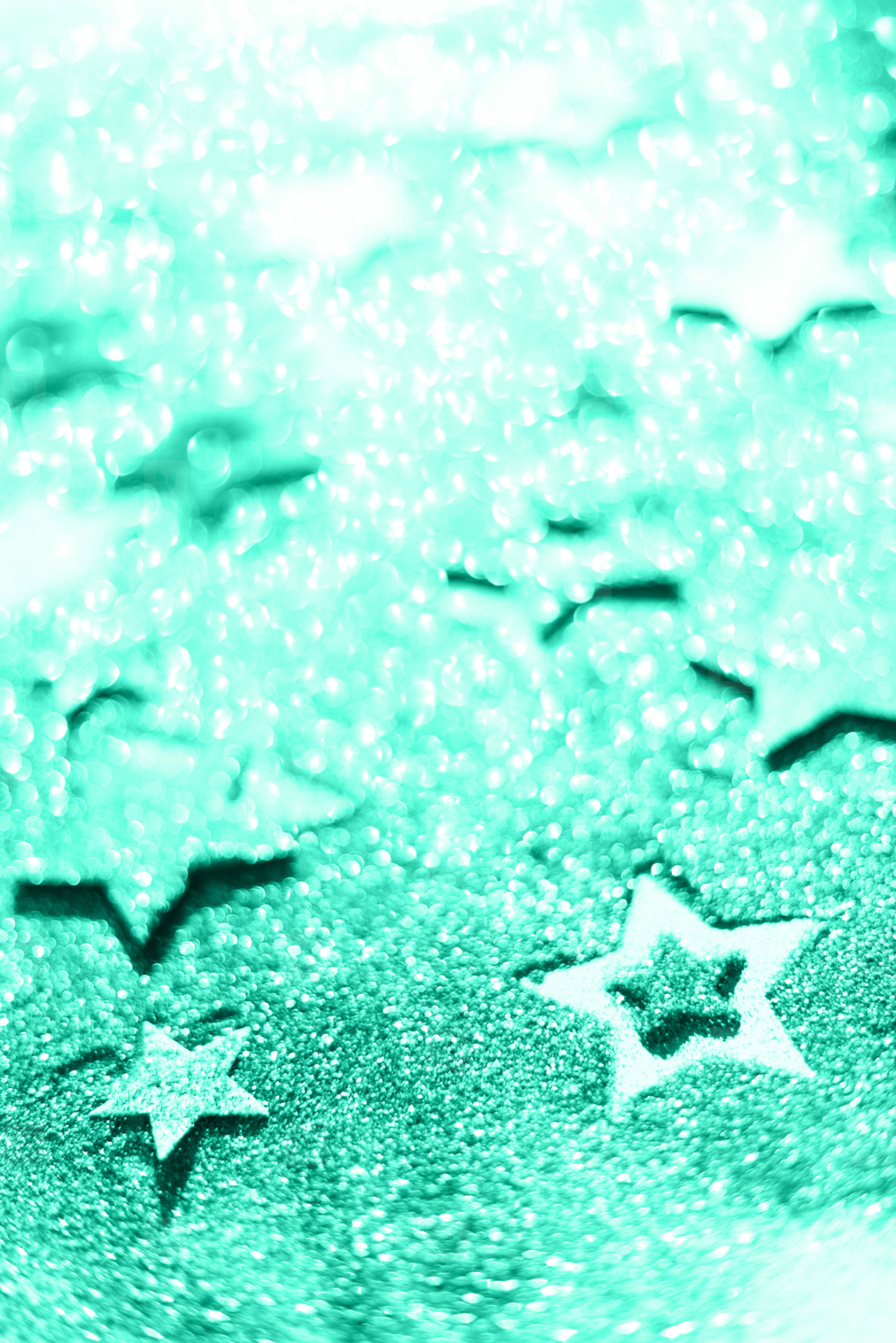 Christmas celebration  Abstract background for new year party  Patter of gold stars with lights  bokeh  Trendy green and turquoise color  Glitter stars in mint color