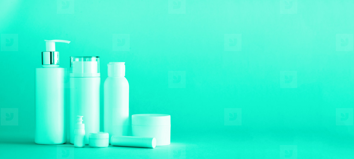 White cosmetic tubes on mint color background with copy space  Skin care  body treatment  beauty concept  Trendy green and turquoise color  Banner