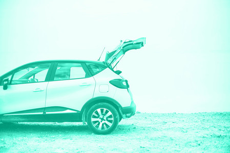 Crossover car on beach road Banner Trendy green and turquoise color Travel summer vacation holiday freedom concept in mint color