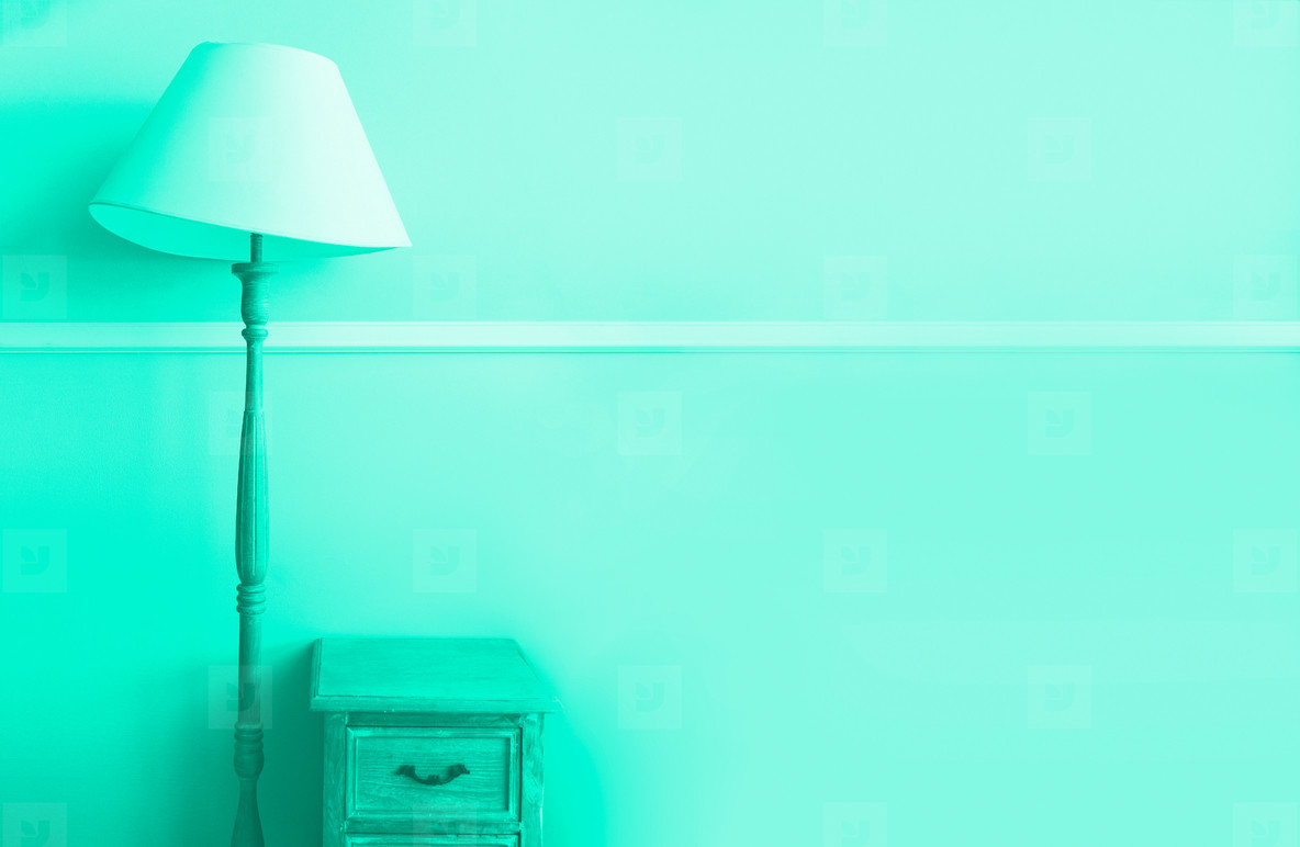 Floor torch lamp  wooden nightstand  curtains on mint color wall background  Banner with copy space  Trendy green and turquoise color  Minimalistic room interior  hildrens room design