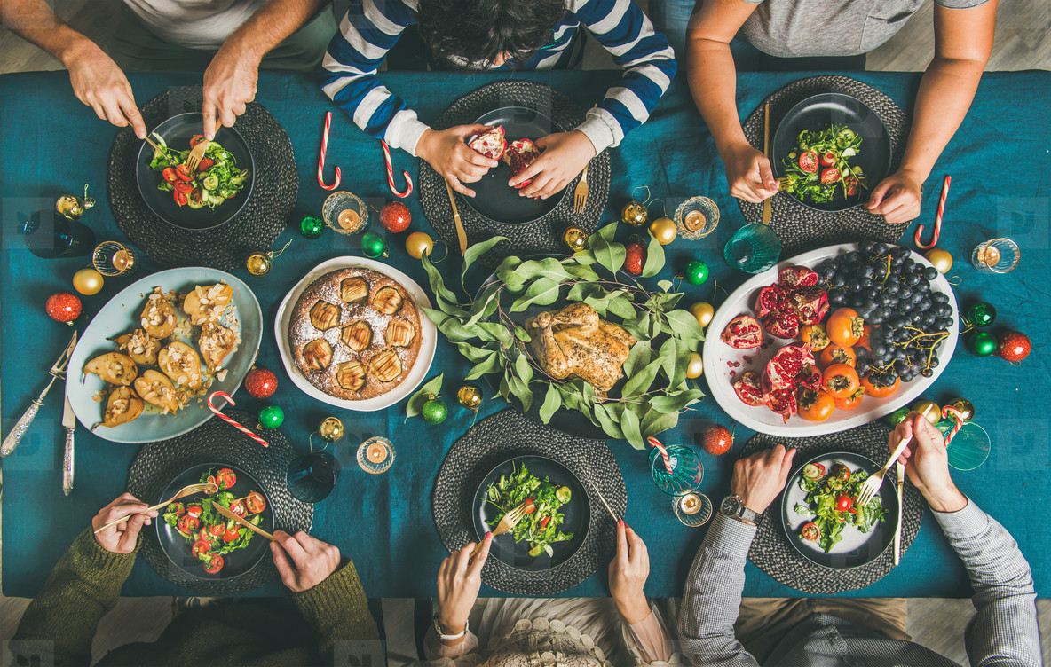 People eating different meals at Christmas party dinner  top view