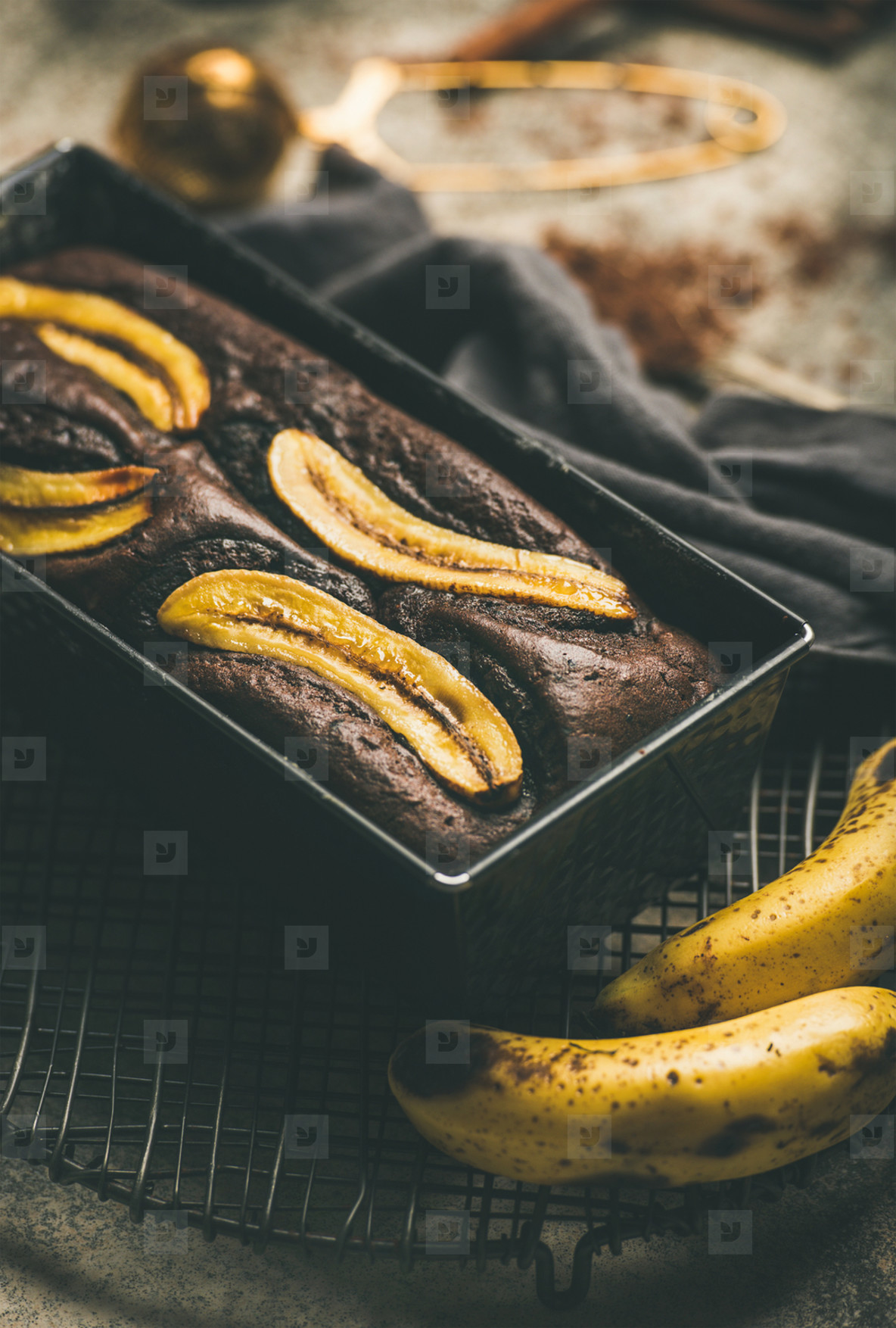 Freshly baked chocolate banana cake with cinnamon in baking tin
