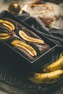 Freshly baked chocolate banana cake with cinnamon in baking tin