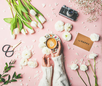 Spring layout with Coffee in female hands flowers sign happy