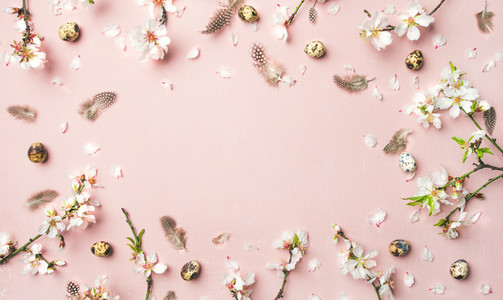 Easter background with eggs  almond flowers and feathers  pink background