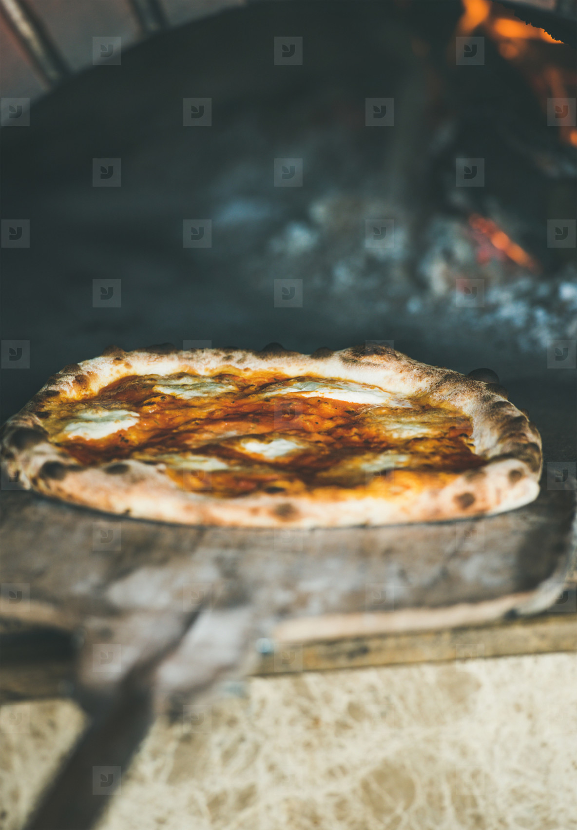 Freshly baked pizza with cheese in pizza wood oven