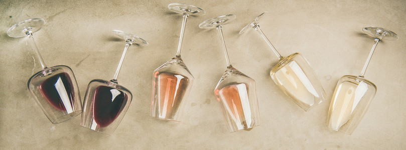 Different wines in glasses and corkscrews  top view