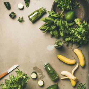 Ingredients for making green smoothie over concrete background  square crop