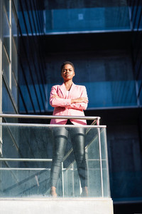 African businesswoman standing near business office building