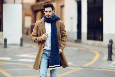Young man wearing winter clothes in the street