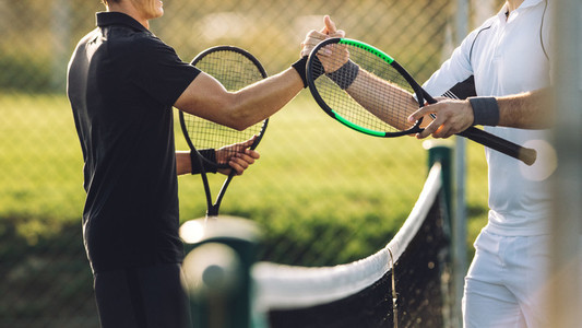 Tennis players shaking hands after the match