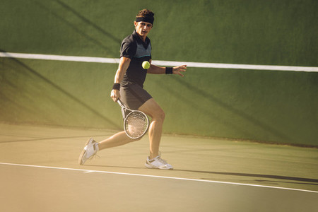 Professional tennis player hitting a strong backhand