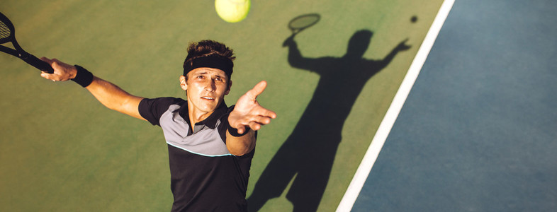 Tennis player about to serve in the game