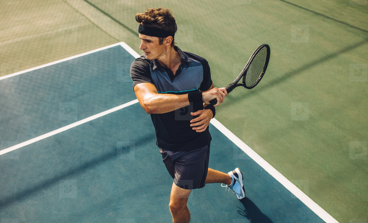 Tennis player practicing forehands