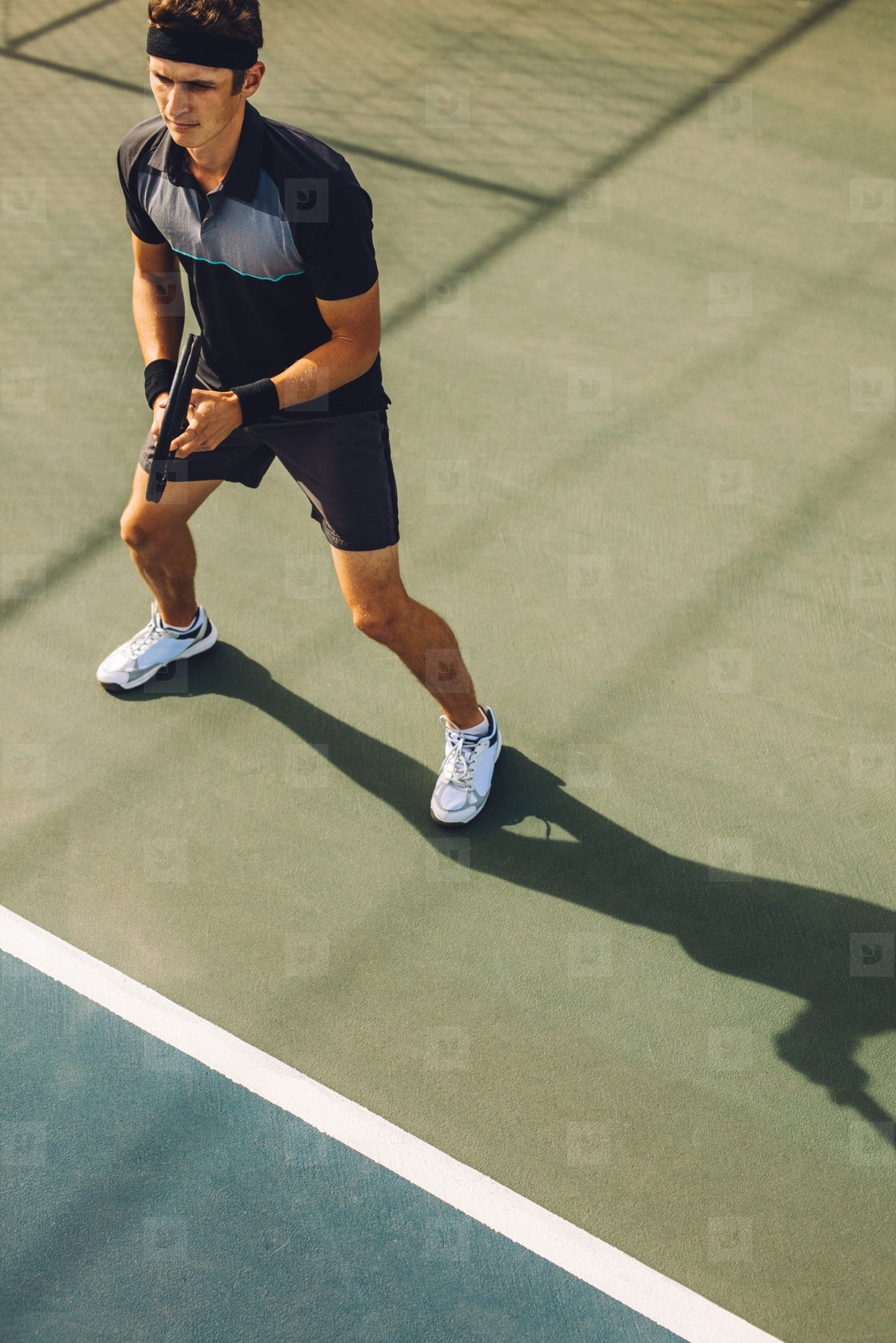 Tennis player ready on the baseline