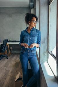 Thoughtful woman entrepreneur