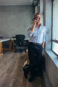 Businessman in conversation over phone
