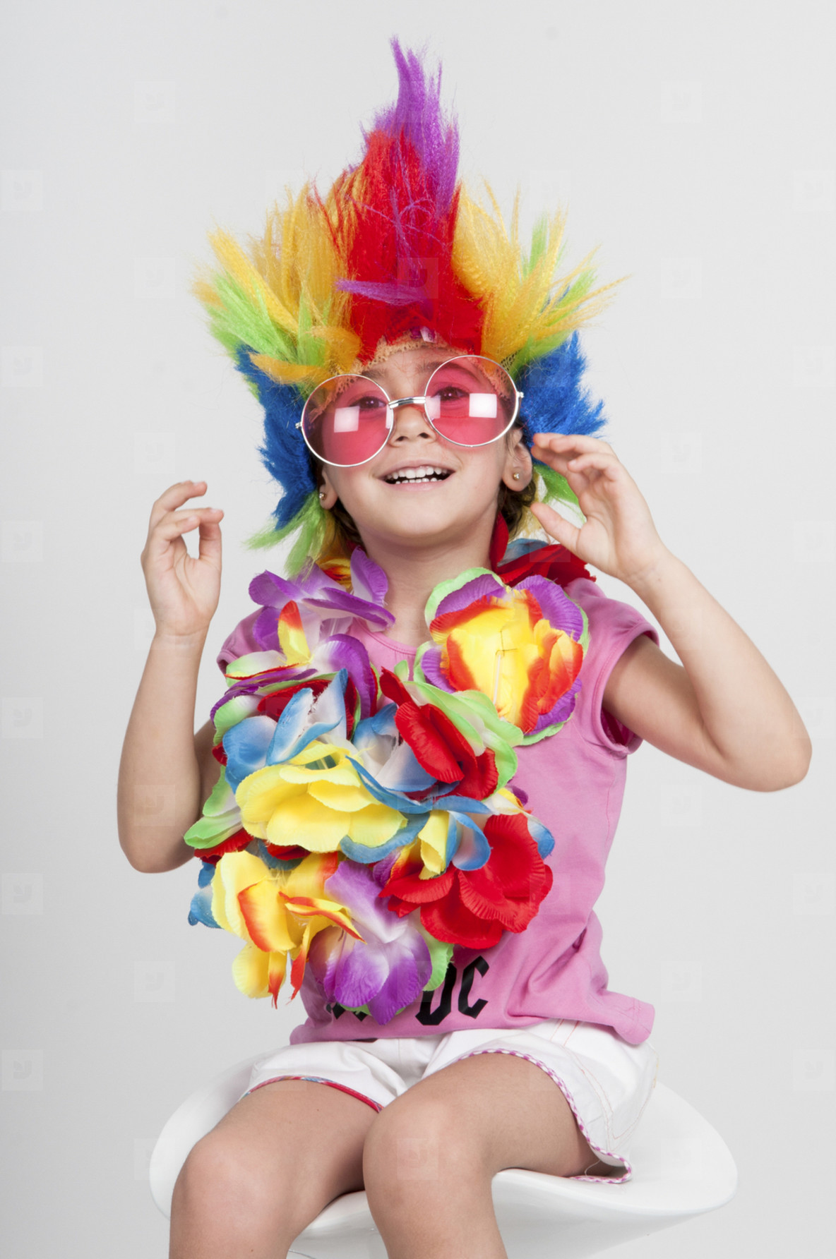 Funny little girl in disguise with wig and sunglasses