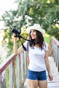 Hiker woman taking photographs with a mirrorless camera