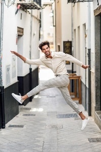 Young funny man jumping in the street