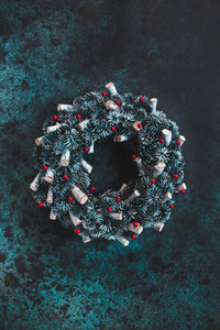 Beautiful Christmas wreath on a blue textured background Top view flat lay copy space