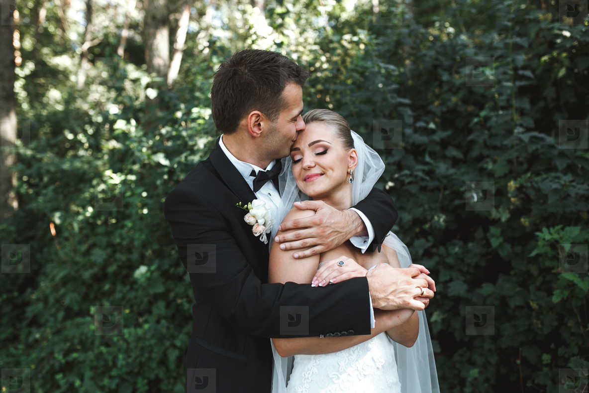 Beautiful wedding couple posing in park