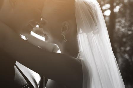Beautiful wedding couple posing in silhouette