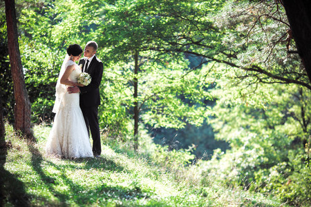 Lovely couple kissing in a wonderful pine forest