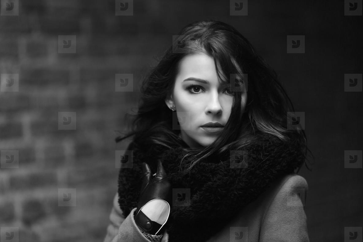 Charming fashion female model in a coat
