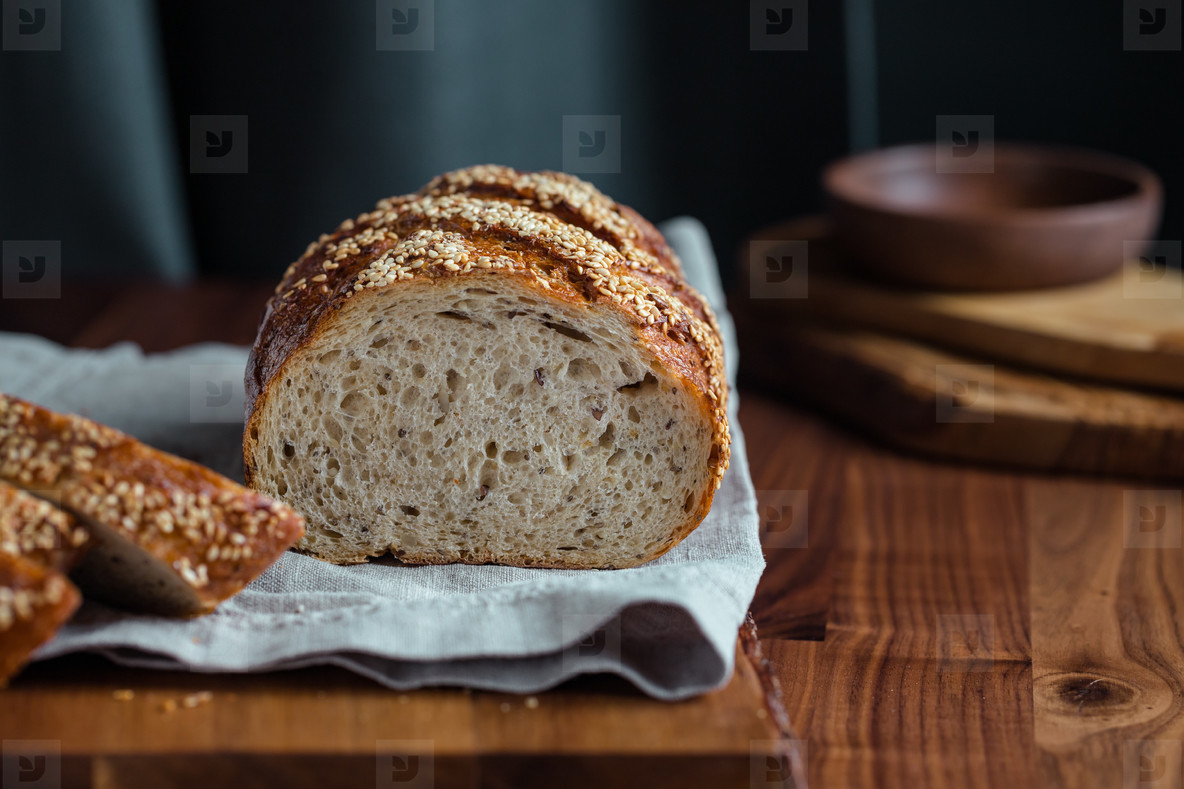 Whole grain loaf bread with chia seeds on a cutting board  Healthy eating concept