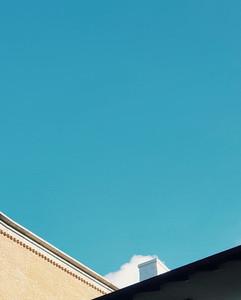 Building contrasting blue sky