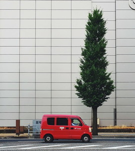 View of a small red japanese van