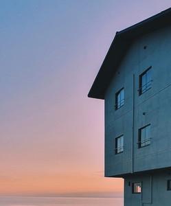 Abstract house facade with sky