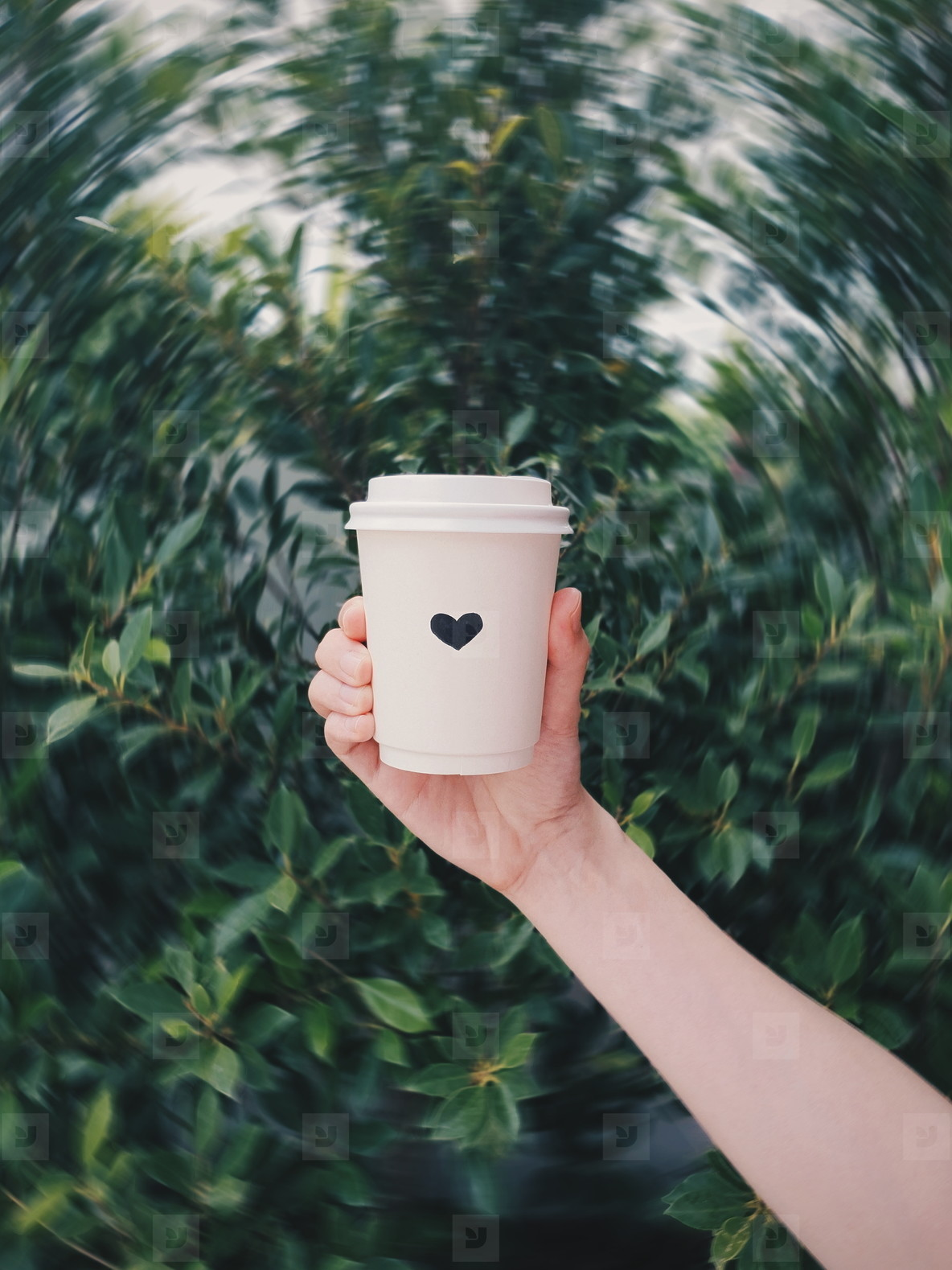 Hand holding paper cup