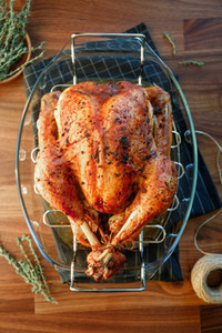 Roasted whole turkey on a table with persimmon  blue grape and lemon for family Thanksgiving Holiday