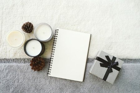 Top view of cozy warm mood with blank notebook planner