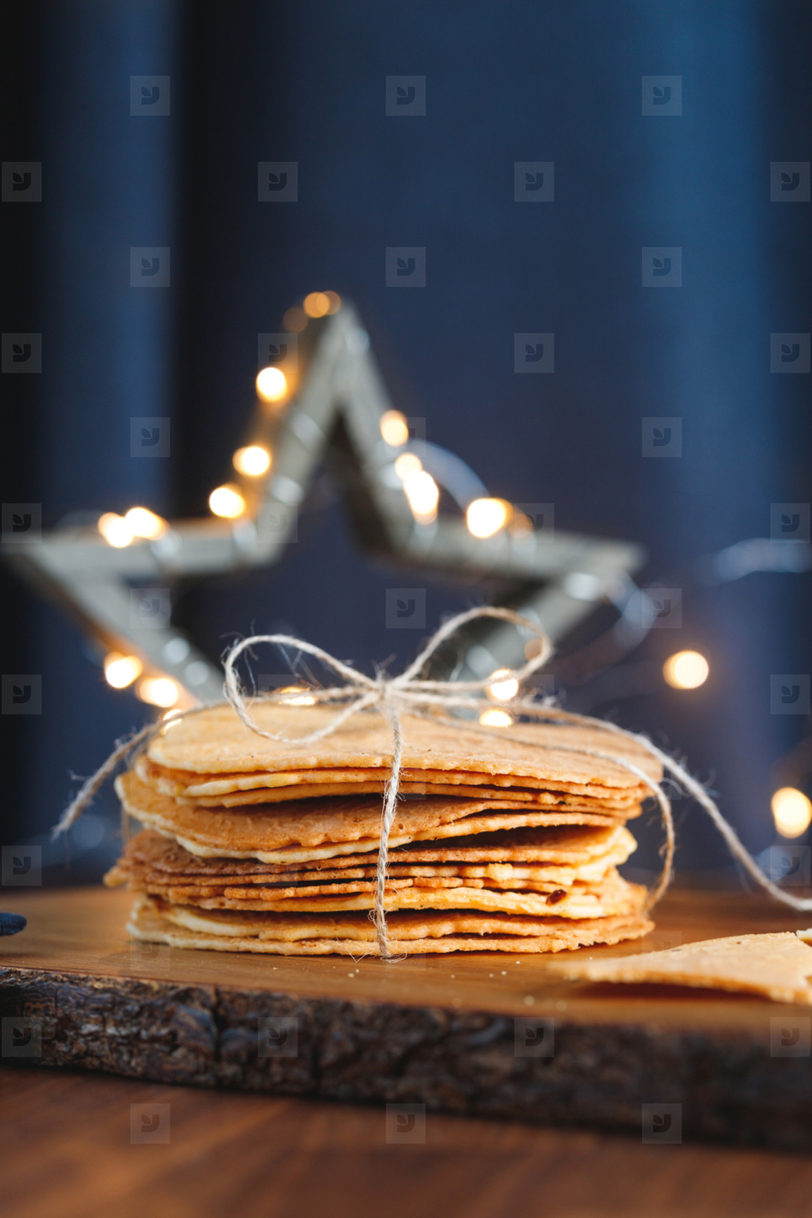Stack of Norwegian crispy round waffles Krumkake on a tray  Concept of home rustic cooking