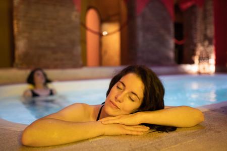 Two women enjoying Arabic baths Hammam in Granada