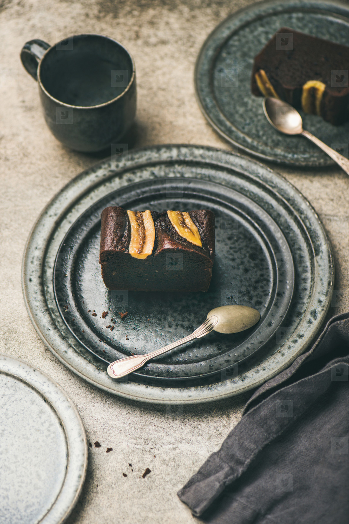Pieces of dark chocolate banana bread cake on plates