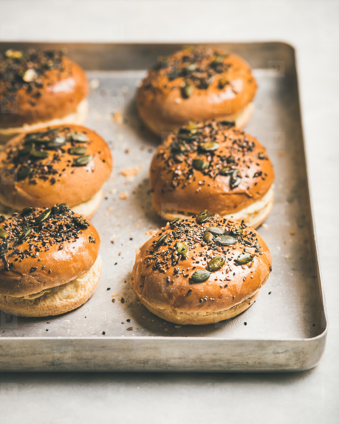 Freshly baked homemade buns with seeds for cooking burgers