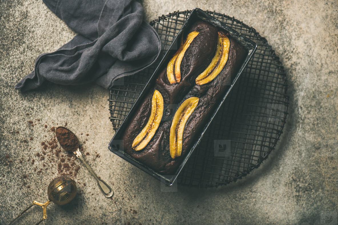 Chocolate banana bread cake with cinnamon in baking tin
