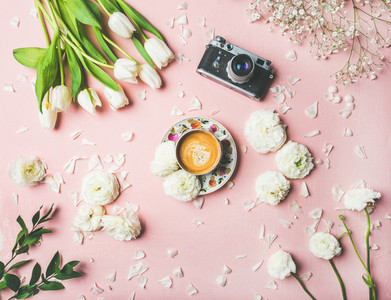 Spring layout with coffee  camera and white flowers