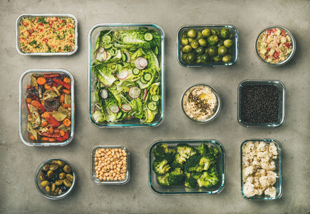 Healthy vegan or vegetarian ingredients and dishes in glass containers